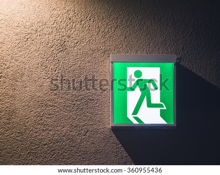 Fire Exit Sign Light box on wall with lighting Building Safety signage  - stock photo