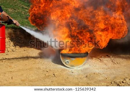 fire extinguisher carbon powder demonstration - stock photo