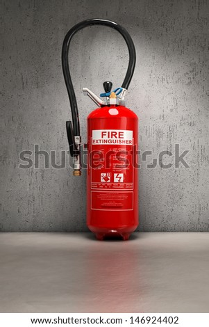 Fire extinguisher on concrete wall - stock photo