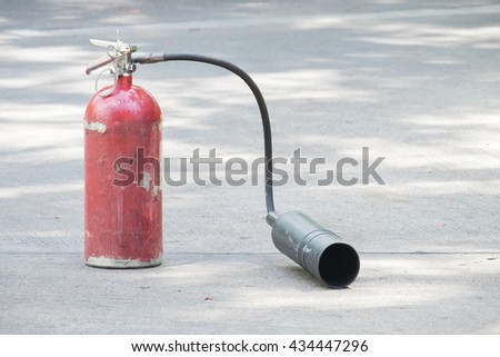 fire extinguisher on the concrete floor. Red Steel Tank outdoor. - stock photo