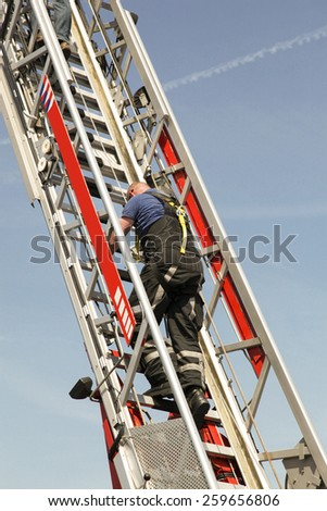 fire fighter Climbing stairs - stock photo