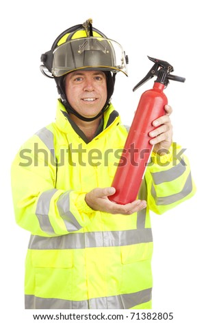 Fire fighter demonstrating how to use a fire extinguisher.  Isolated on white. - stock photo