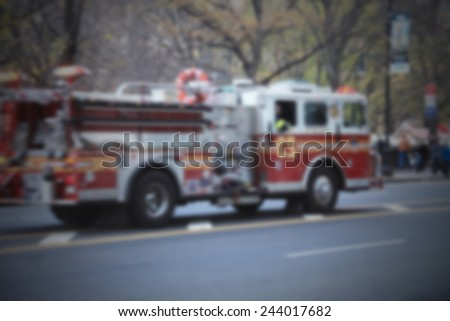 Fire fighters, NYC. Intentionally blurred post production. - stock photo