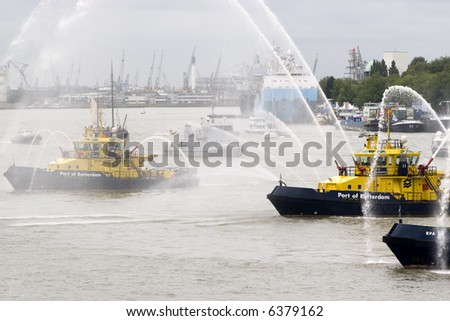 Fire Fighting Boat sprays jets of water - stock photo