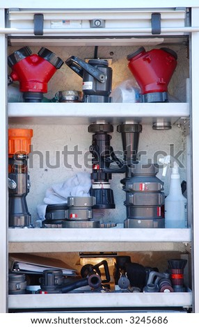 fire fighting equipment on fire truck - stock photo