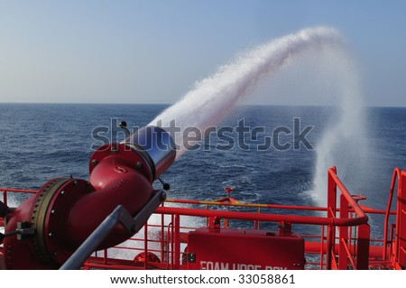 Fire fighting foam/water gun onboard of tanker ship - stock photo