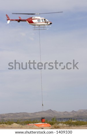 Fire fighting helicopter practicing - stock photo