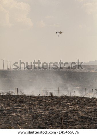 Fire fighting helicopters - stock photo