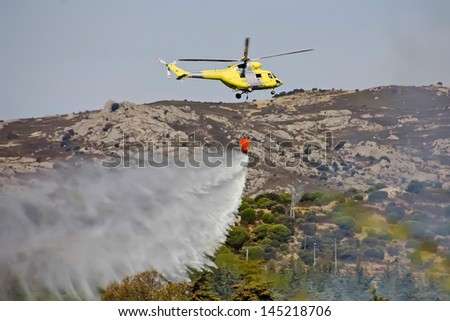fire fighting helicopters fire on the mountain - stock photo