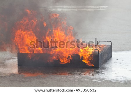 Fire flame burning in container on fire safety training