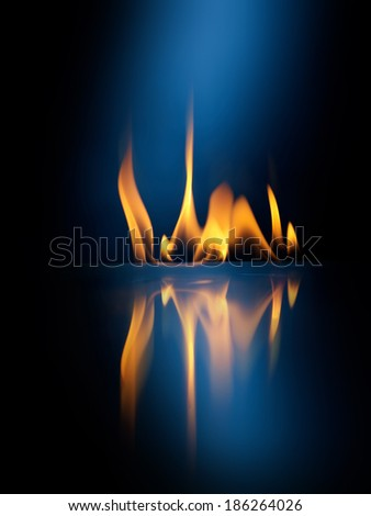 Fire flame on black background - stock photo