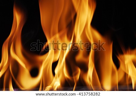 Fire flames against black background