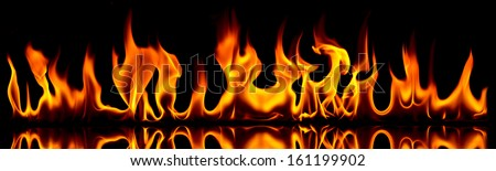 Fire flames on a black background. - stock photo