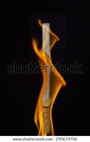 fire flames on cigarette background, black background, - stock photo