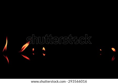 fire flames reflected in black background