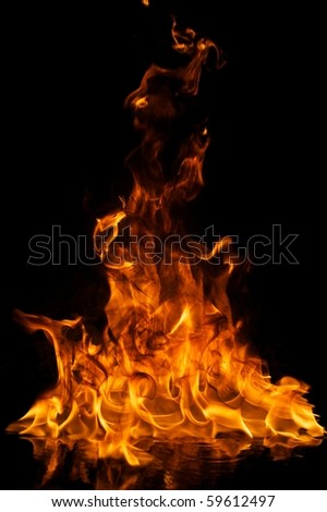 Fire flames reflected in water - stock photo