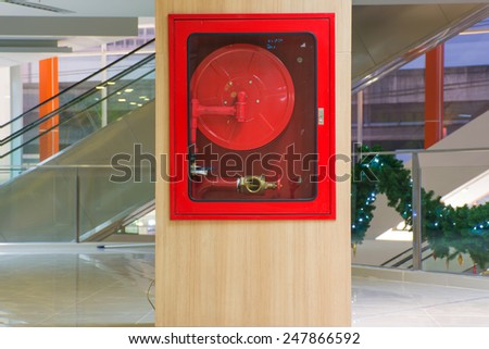 Fire hose cabinet in the mall. - stock photo
