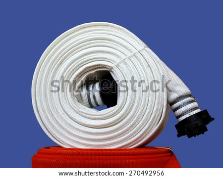 Fire hose of  white color, wound into coil - stock photo