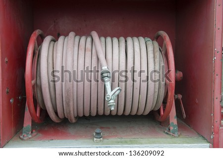 Fire hose on truck - stock photo