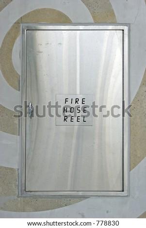 Fire hose reel housing - stock photo
