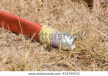 Fire hose with connector - stock photo
