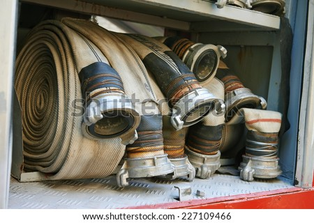 fire hoses equipment in firetruck - stock photo