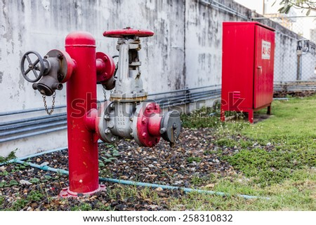 fire hydrant and hydrant hose box - stock photo