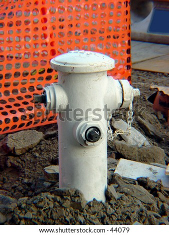 Fire hydrant at a construction site - stock photo