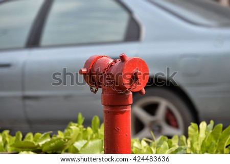 Fire hydrant at roadside. - stock photo