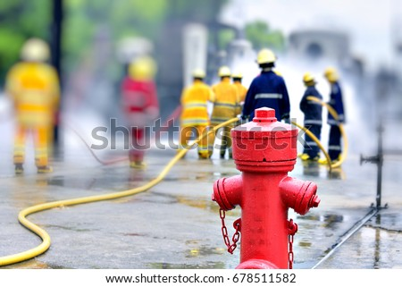 Fire hydrant , hose connection ,fire fighting equipment for fire fighter and Firemen in action background .