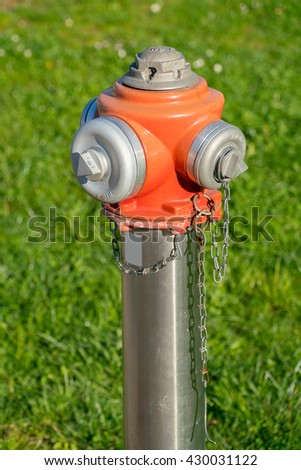 Fire hydrant. Hydrant close up. Hydrant closeup. Single fire hydrant. Hydrant fire safety. Red orange hydrant. Water hydrant. Modern hydrant. New hydrant. Contemporary hydrant. Hydrant fire plug urban - stock photo