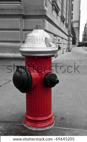 Fire hydrant in the street of New York City. B/W picture with red hydrant. - stock photo