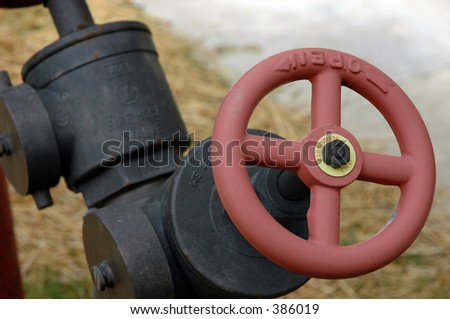 Fire hydrant valve - stock photo