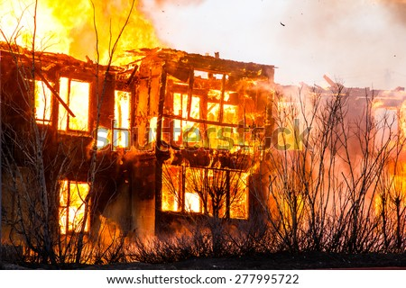 Fire in a house - stock photo