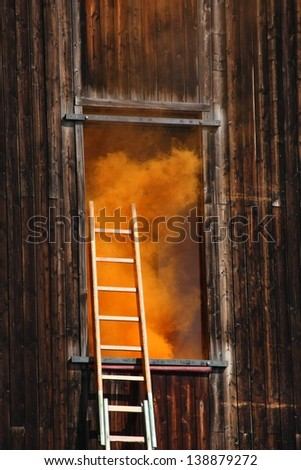 fire in a House with thick orange smoke coming out from the - stock photo