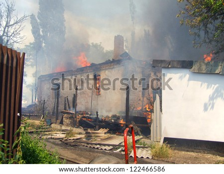 Fire in an abandoned house the poor - stock photo