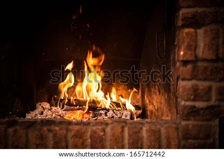 Fire in fireplace. Closeup of firewood burning in fire