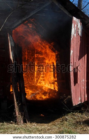 fire in red barn