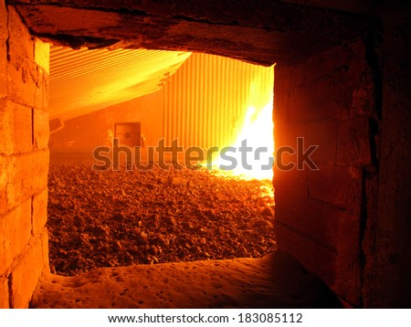 fire in the boiler furnace grate, the view through the hatch  - stock photo
