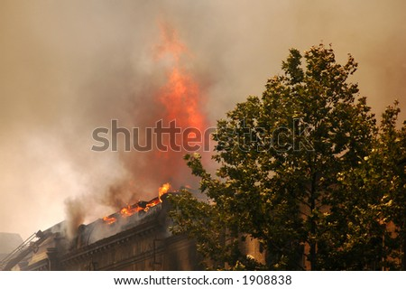 Fire in the city center - stock photo