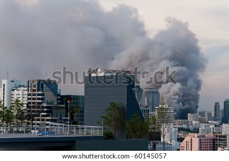 Fire in the city overview. - stock photo