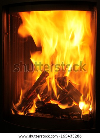 Fire in the fireplace - stock photo