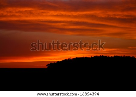 Fire in the sky at sunset early in the evening - stock photo