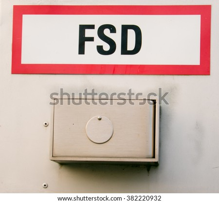 Fire Key depot A sign in german language the letters stand for Feuerwehr Schlüssel Depot in english Fire Key depot. - stock photo