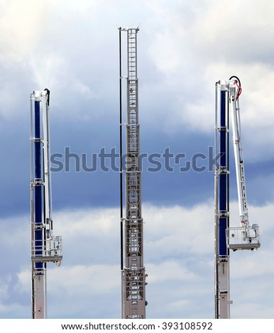 Fire ladders are designed for delivery of the fire fighting and calculation of fire and technical equipment, emergency rescue work at height and the extinguishing agent to the height - stock photo