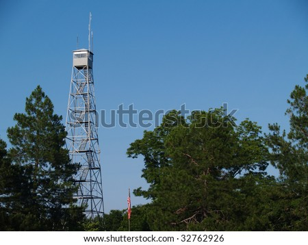 Fire lookout tower in south Georgia against a beautiful blue sky. - stock photo