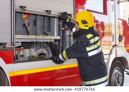 Fire mans on duty,under exposed and colored photo - stock photo