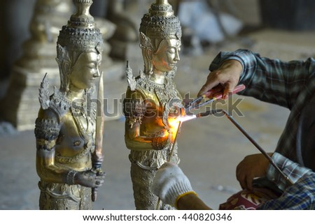 fire on buddha factory manufacture - stock photo