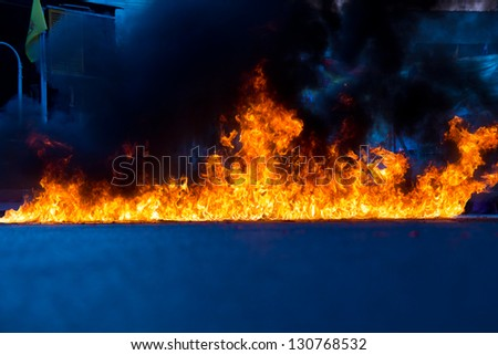 Fire on the orange - blue. - stock photo