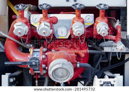 Fire pump panel on fire truck. Discharge gauges and piston valve - stock photo